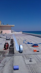 160' of trenchless roof rain drain pipe lining at Atlantic Towers, Port Everglades